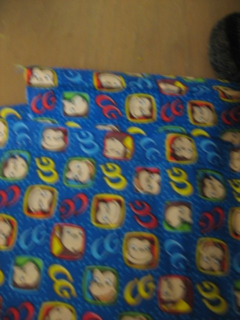 Image 0 of Curious George smiling faces initials on blue 21 inch long by 44 inch wide