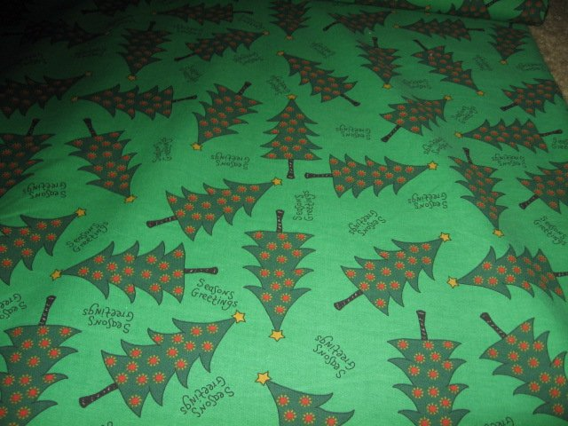 Christmas trees seasons greetings on green fabric by the yard