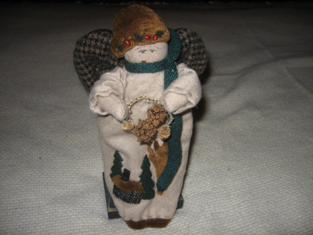 Christmas Angel stand  11 inch wings cabin trees collectible