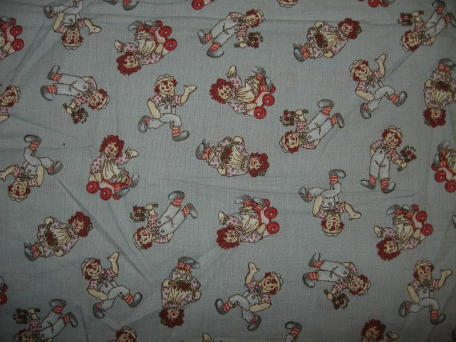 Raggedy Ann and Andy wagon flowers tiny pictures cotton fabric by the yard