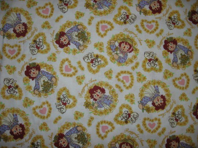 Image 0 of Raggedy Ann hearts flowers yellow   cotton fabric by the yard