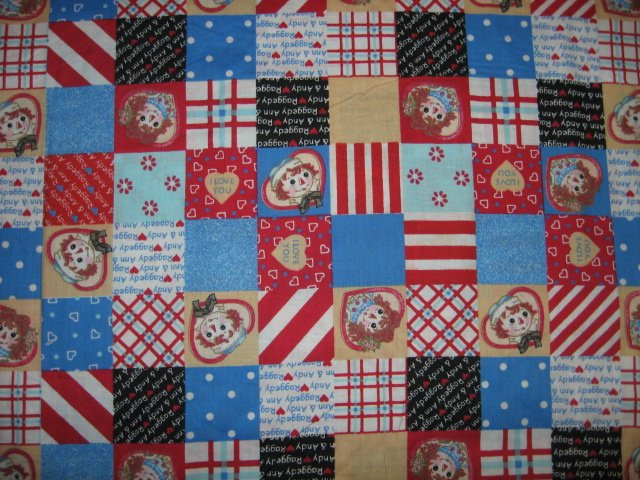 Image 0 of Raggedy Ann Andy patchwork red blue squares hearts cotton fabric by the yard