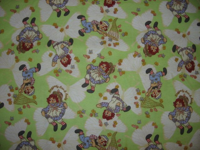 Raggedy Ann Andy butterflies green flannel Fabric by the Yard