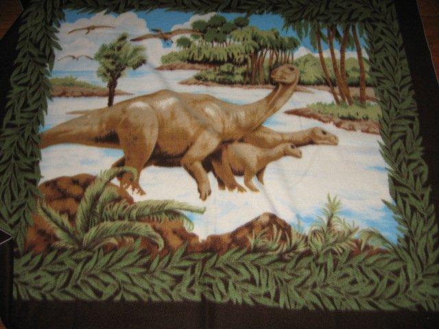 Dinosaur family habitat fleece bed blanket