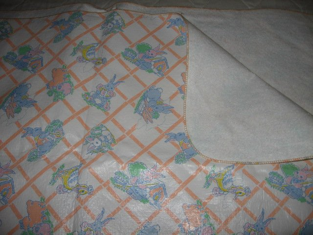 Vintage looking rabbits ducks sheep vinyl pink white table cover