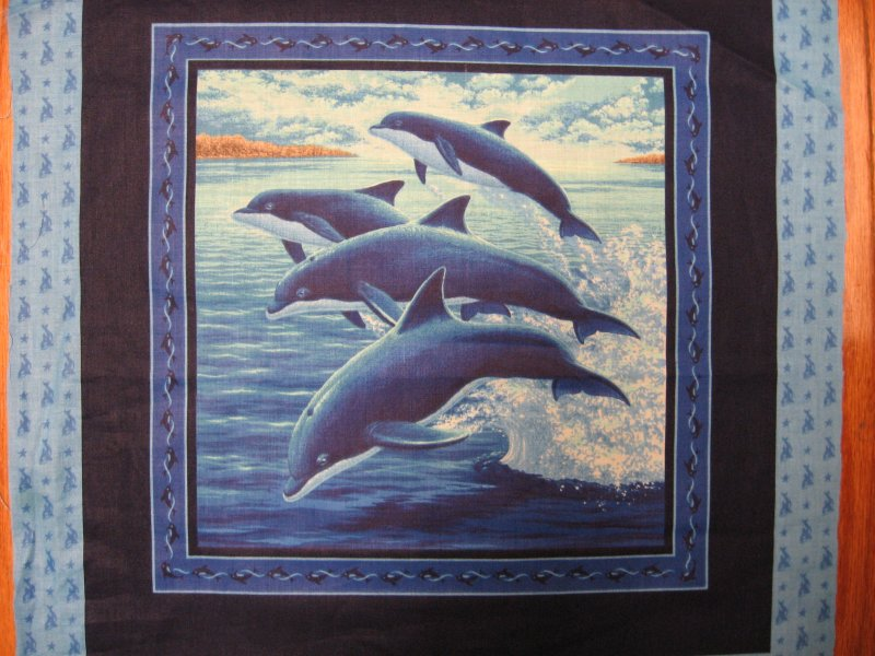 Image 1 of Dolphins fish in the sea ocean waves fabric pillow panels set of two pictures