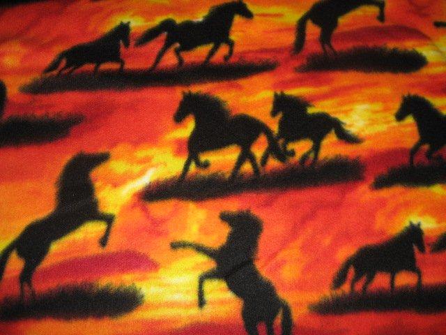 Horses running wild in Sunset fleece blanket