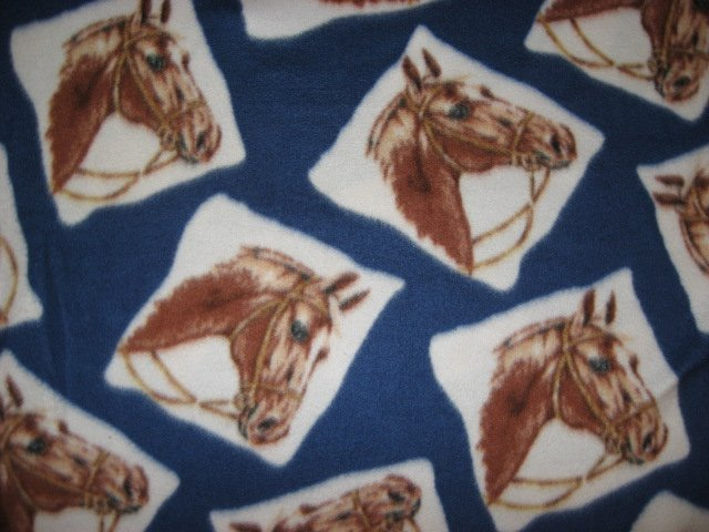 Horse heads on blue fleece by the yard make a tie blanket or sew /