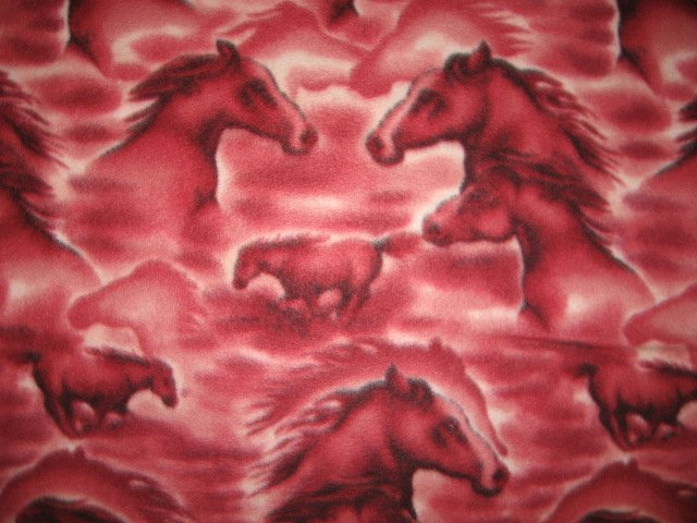 Horse heads on cranberry fleece bed blanket 72