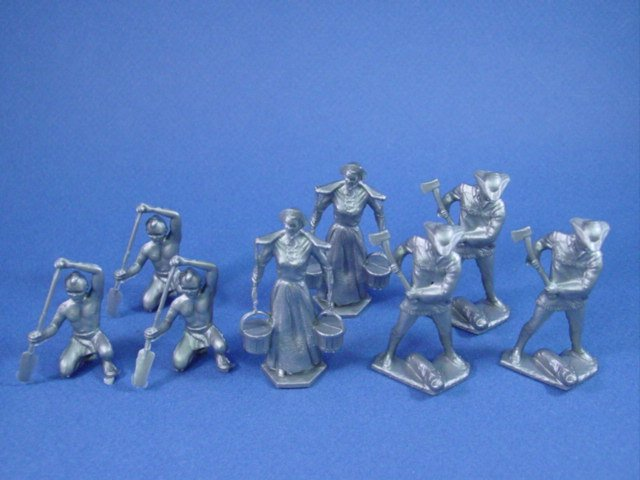 Marx 54mm Pioneer Family with Indian Paddler cast in silver. Complete 8 piece set.