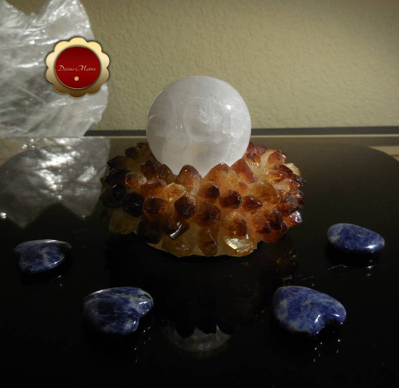 Image 2 of 50mm Carved Selenite Moonface Sphere Removes Energy Blocks