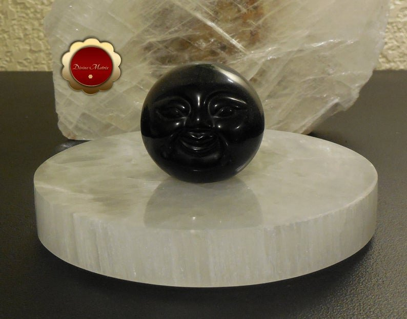 Image 0 of 50mm Black Obsidian Sphere Carved Moon Face Psychic Protection Stone
