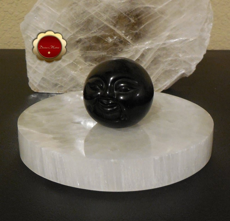 Image 2 of 50mm Black Obsidian Sphere Carved Moon Face Psychic Protection Stone